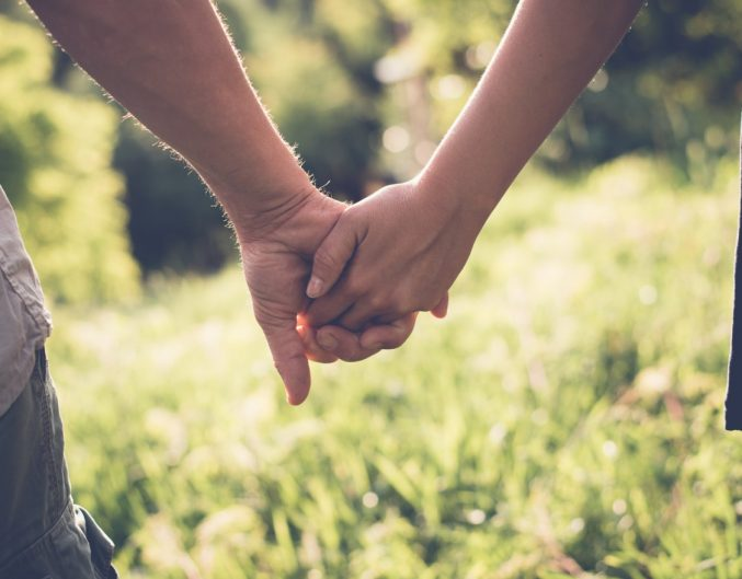 couple holding hands, romantic things to do