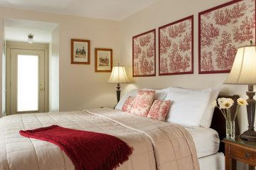 room 1 bedroom with bed, wall art, red decor