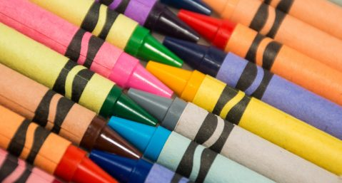 Closeup of multuplie colored crayons on a diagonal array