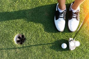 golf shoes and ball